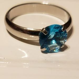 Silver band blue stone